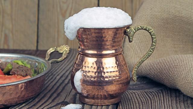 Ayran - Traditional Turkish yoghurt drink in a copper metal cup