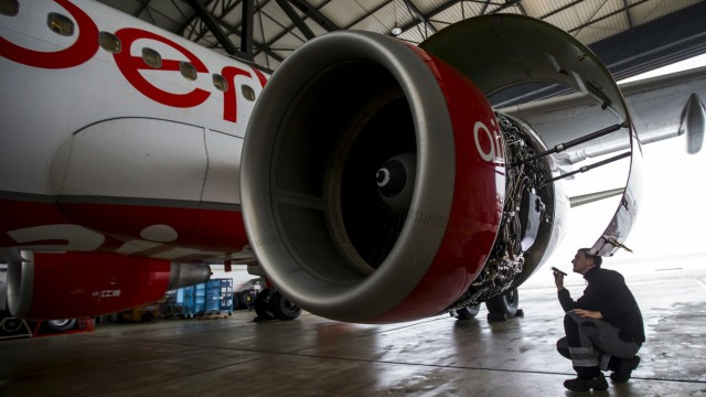 File photo of an Air Berlin technician inspecting a jet engine of an Air Berlin plane in a hangar at Tegel Airport in Berlin