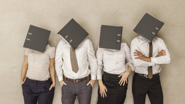Business people with covered head by folders model released PUBLICATIONxINxGERxSUIxAUTxHUNxONLY BAEF