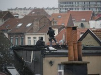 BRUSSELS BELGIUM Snipers of the special police forces pictured on a roof top near the scene of
