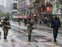 Belgian soldiers patrol in central Brussels after security was tightened in Belgium following the fatal attacks in Paris