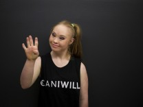 18-year-old model with Down syndrome, Madeline Stuart poses for a photo at a designer fitting and casting event at King's College in Manhattan