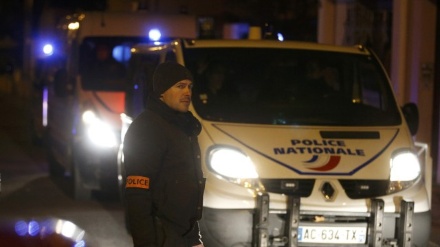 French police cordon the area after an alleged explosive belt was found in Montrouge