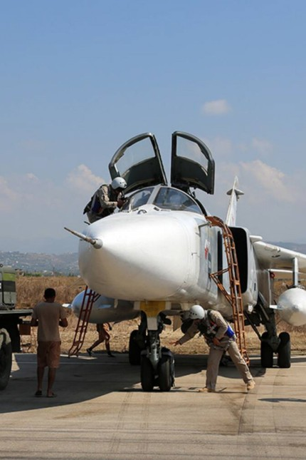 LATAKIA SYRIA OCTOBER 4 2015 Russia s Sukhoi Su 24 attack aircraft at the Hmeymim airbase TASS