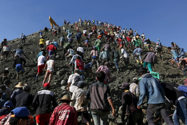 Miners search for jade stones at a mine dump in a Hpakant jade mine at Kachin state, Myanmar