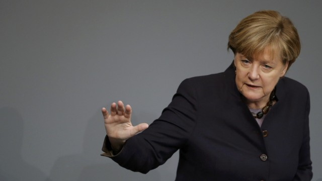 German Chancellor Merkel addresses a session of the German lower house of parliament, the Bundestag, in Berlin