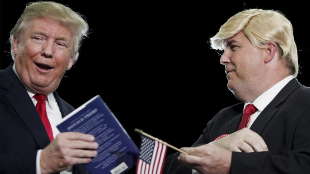 U.S. Republican presidential candidate Donald Trump brings a look-alike supporter Terry Silliman of Goose Creek, South Carolina on stage during a rally at the Myrtle Beach Convention Center in Myrtle Beach, South Carolina