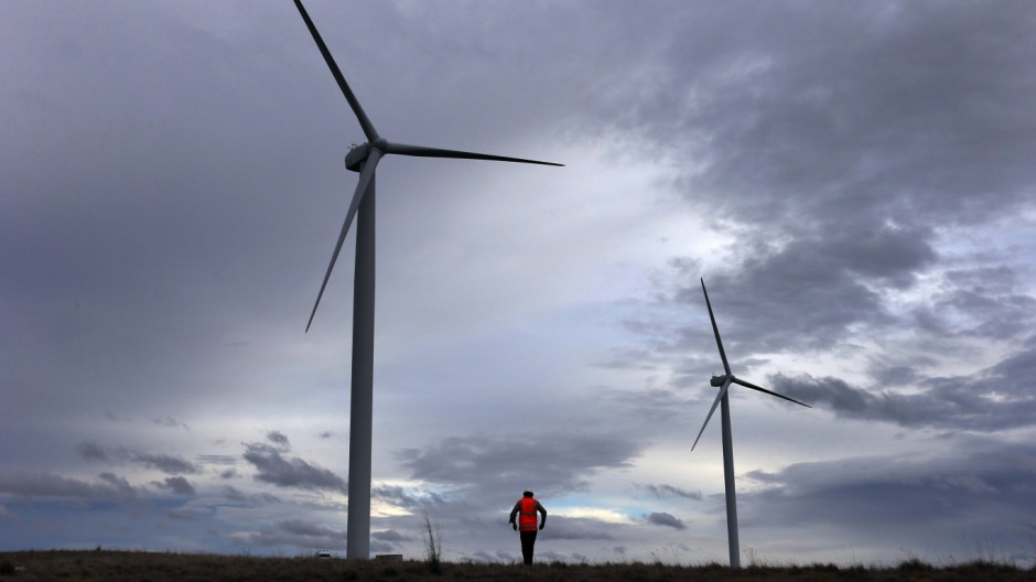 David Brockwell walks between wind turbines during a routine inspection at the Infigen Energy wind farm located on the hills surrounding Lake George, 50 km north of the Australian capital city of Canberra