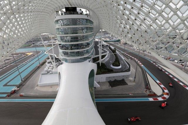 Formula one cars are seen passing underneath Yas Marina hotel during the third free practice session of Abu Dhabi F1 Grand Prix at the Yas Marina circuit in Abu Dhabi