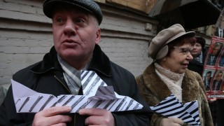 ST PETERSBURG RUSSIA NOVEMBER 27 2015 People hold striped paper planes during a protest outside