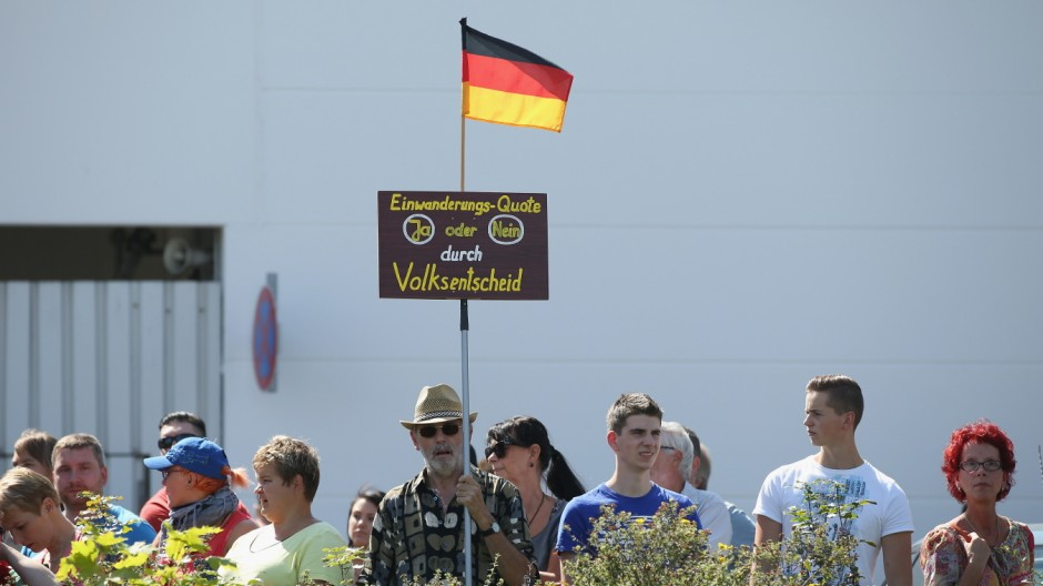 Merkel Visits Heidenau Asylum Shelter Following Violent Protests