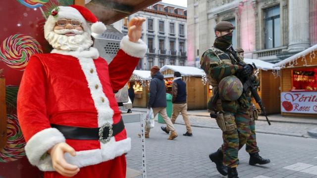 Belgian soldiers patrol along 'Winter Wonders', a Christmas market in central Brussels