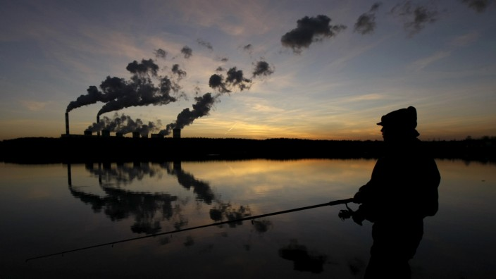 File photo of a man fishing in an artificial lake outside Belchatow Power Station