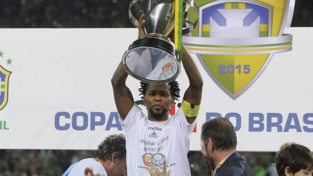 Ze Roberto of Palmeiras holds up the trophy after winning their Copa do Brasil final soccer match against Santos in Sao Paulo