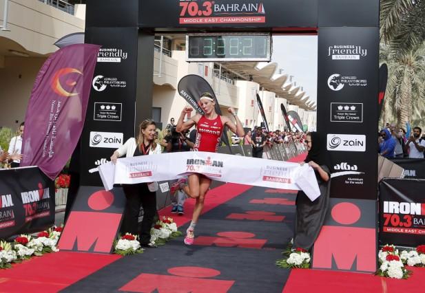 Switzerland's Daniela Ryf crosses the finish line of the Iron-Man 70.3 Bahrain Middle East Championship at  Manama, Bahrain