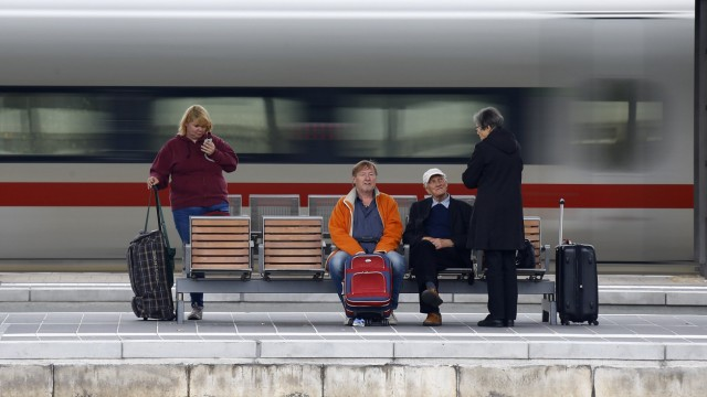 Passengers of German railway Deutsche Bahn are seen at Frankfurt's main railway station