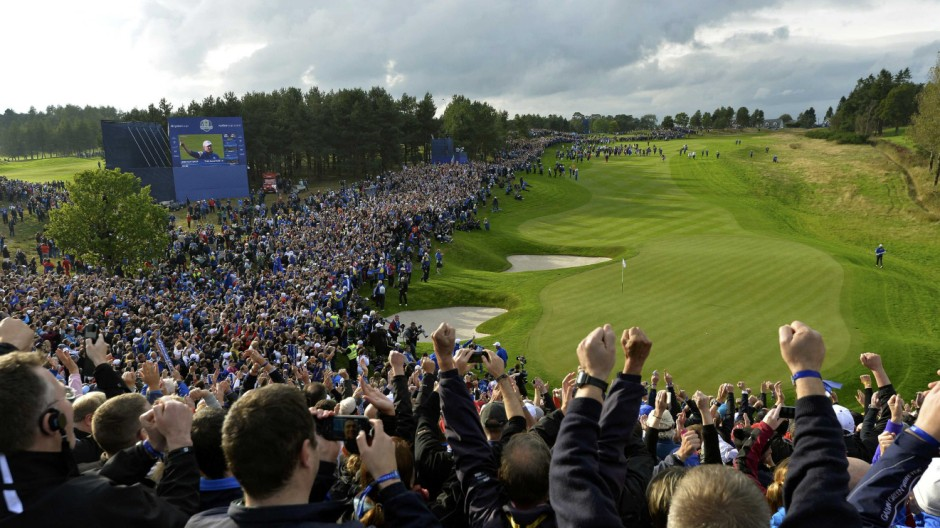Crowds react as Team Europe golfer Jamie Donaldson hits his ball onto the 15th green during the 40th Ryder Cup at Gleneagles