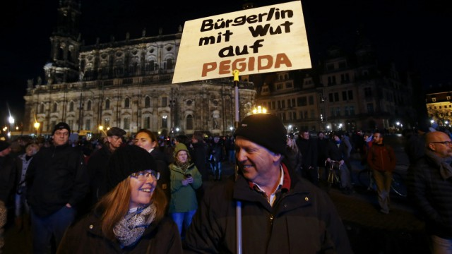 Opponents of the anti-immigration right-wing movement PEGIDA (Patriotic Europeans Against the Islamisation of the West) gather in Dresden