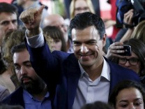 Spain's Socialist Party (PSOE) leader Pedro Sanchez waves after a news conference at the party's headquarters after results were announced in Spain's general election in Madrid
