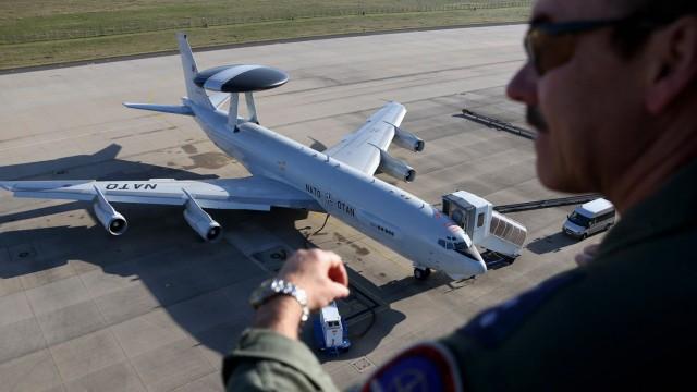 NATO officer watches a AWACS aircraft at AWACS air base in Geilenkirchen near the German-Dutch border