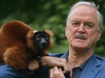 John Cleese Meets Colin The Lemur At Bristol Zoo