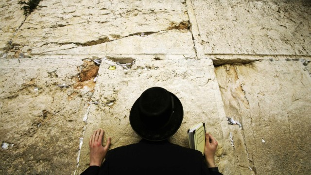 An Ultra Orthodox Israeli Jew prays at Jerusalem's Western Wall in solidarity for residents of south Israel