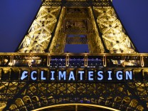 151213 PARIS Dec 13 2015 The slogan CLIMATESIGN is seen on the Eiffel Tower in Paris Fra
