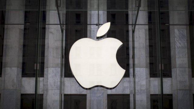 File photo of an Apple logo hanging above the entrance to the Apple store on 5th Avenue in the Manhattan borough of New York City