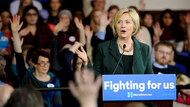 U.S. Democratic presidential candidate Clinton asks attendees for a show of hands from those who have caucused during a town hall event at Old Brick Church and Community Center in Iowa City, Iowa