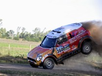 Guo Meiling of China jumps her Mini into the road during the 38th Dakar Rally in Arrecifes