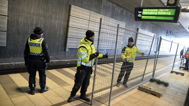 A temporary fence is erected between domestic and international tracks is seen at Hyllie train station in southern Malmo