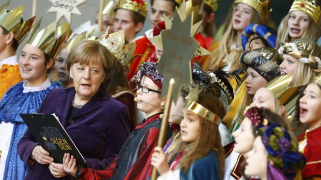German Chancellor Merkel attends reception for carol singers in Berlin