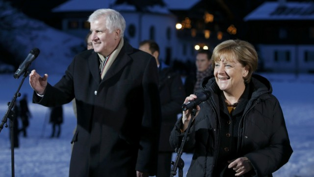 German Chancellor Merkel and Bavarian state premier and leader of CSU Seehofer make an address CSU Epiphany meeting in Wildbad Kreuth