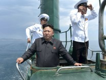 File photo of North Korean leader Kim Jong Un standing on the conning tower of a submarine during his inspection of the KPA Naval Unit 167