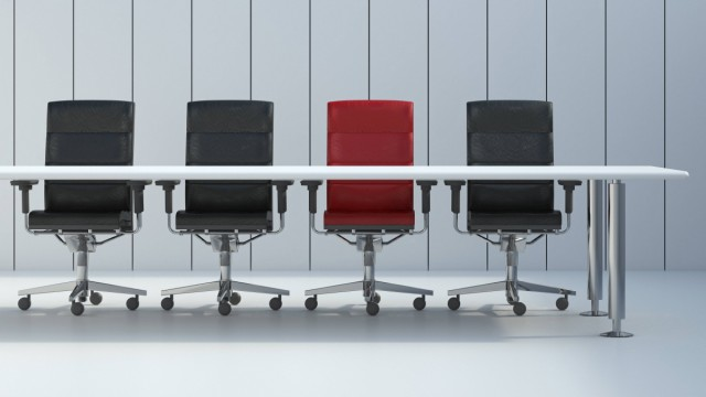 Four office chairs and conference table in front of grey wall panel 3D Rendering PUBLICATIONxINxGER