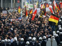 Supporters of anti-immigration right-wing movement PEGIDA protest in Cologne