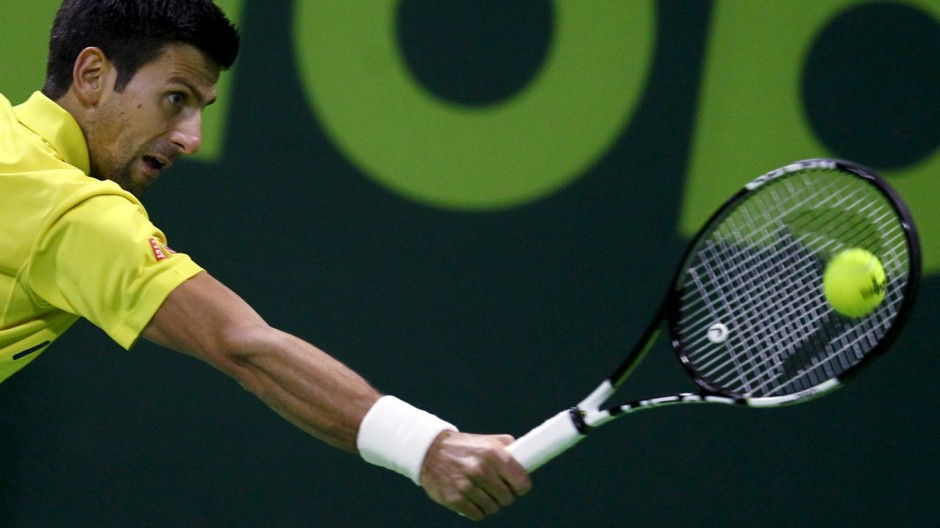 Djokovic of Serbia returns the ball to Nadal of Spain during their Qatar Open men's single tennis final match in Doha