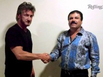 Undated Rolling Stone handout shows actor Sean Penn shaking hands with Mexican drug lord Joaquin 'Chapo' Guzman in Mexico