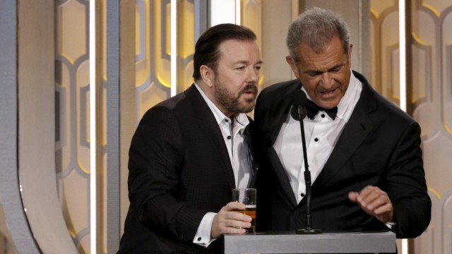 Handout photo of host Ricky Gervais standing with presenter Mel Gibson at the 73rd Golden Globe Awards in Beverly Hills