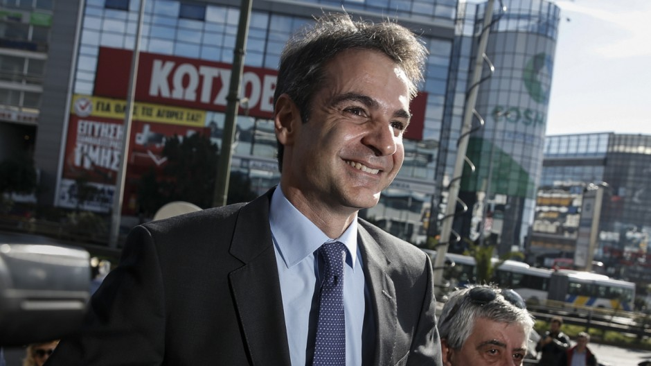 Newly elected leader of Greece's conservative New Democracy party Mitsotakis arrives at the party's headquarters, a day after winning the party elections