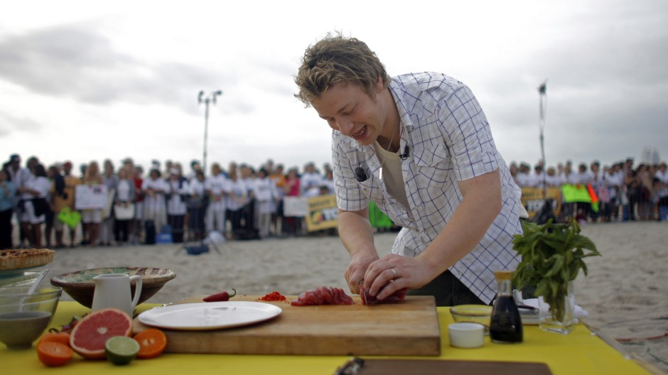 The Naked Chef Jamie Oliver slices fish during an appearance on NBCs Today show in Miami Beach