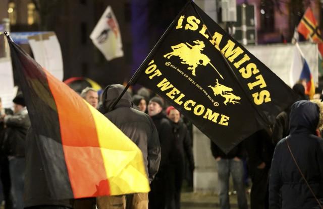 Members of LEGIDA, the Leipzig arm of the anti-Islam movement PEGIDA, take part in a rally in Leipzig