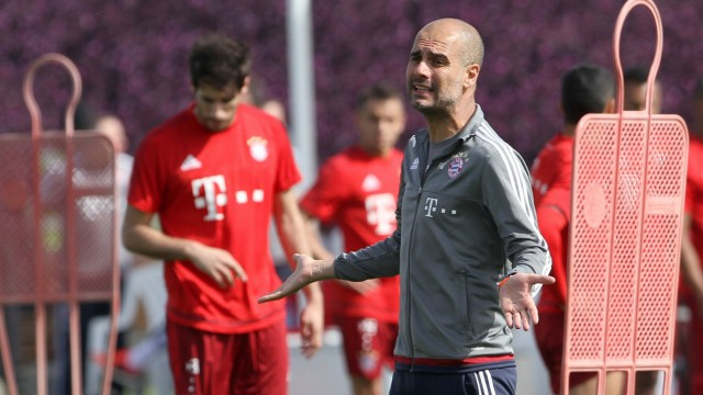 Bayern Munich's coach Pep Guardiola gestures during a training session at his team winter training camp in Doha