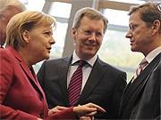 Kanzlerin Merkel, Christian Wulff und Guido Westerwelle; dpa