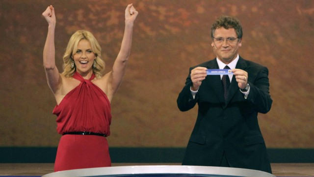 South African actress Theron cheers as FIFA general secretary Valcke holds up a slip of paper with name South Africa during 2010 World Cup draw in Cape Town