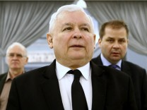 Jaroslaw Kaczynski (C), leader of the ruling Law and Justice (PiS) party, attends a Parliament session in Warsaw