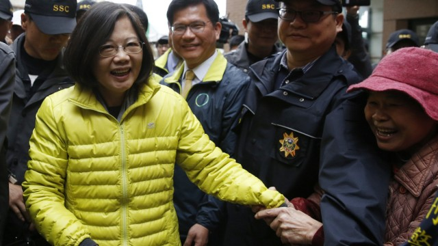 Taiwan's Democratic Progressive Party Chairperson and presidential candidate Tsai Ing-wen greets a supporter at a campaign rally ahead of the election in Taichung