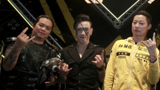 Freddy Lim, a candidate to the 2016 legislative election and singer of death metal band Chthonic, and members of Chthonic pose for photographers during an interview with reporters after a concert to boost his campaign in Taipei