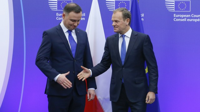 Poland's President Andrzej Duda is welcomed by European Council President Donald Tusk ahead of a meeting at the European Council in Brussels