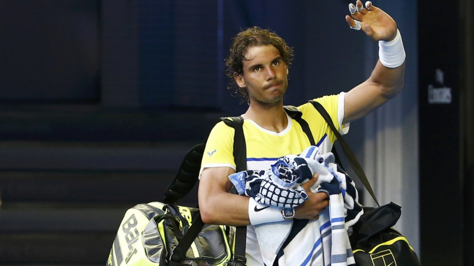 Spain's Nadal waves to the crowd as he leaves after losing his first round match against Spain's Verdasco at the Australian Open tennis tournament at Melbourne Park, Australia